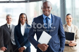 stock-photo-36411644-african-businessman-with-group-of-businesspeople
